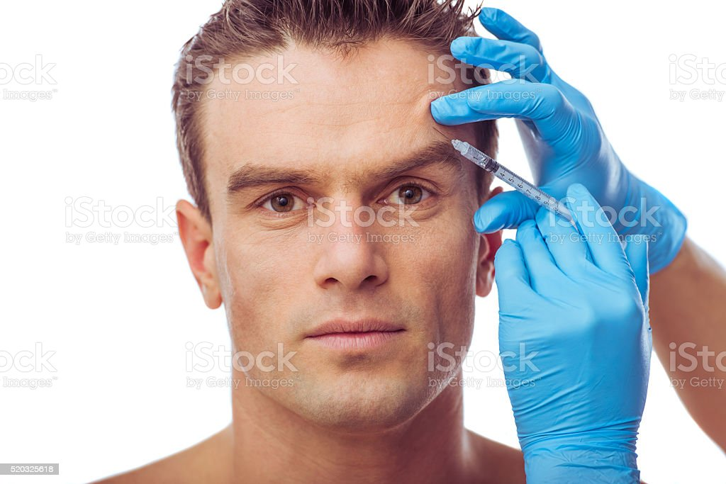 Handsome man and plastic surgery bildbanksfoto