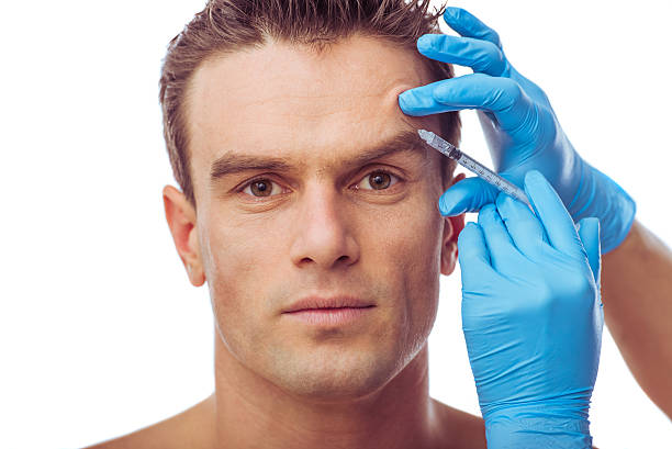 Handsome man and plastic surgery stock photo