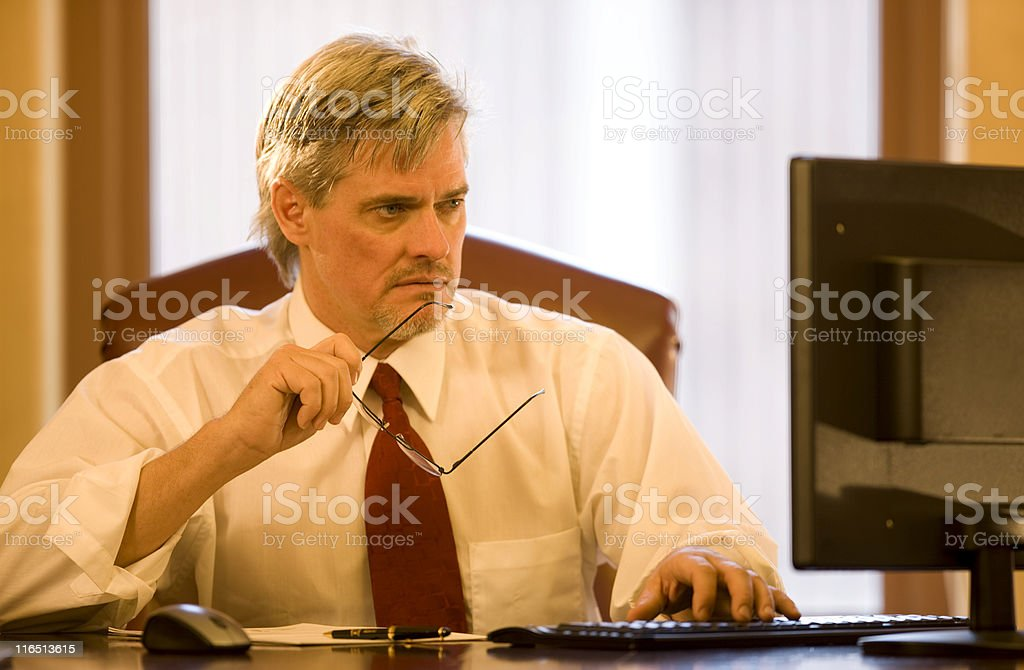 Handsome Man At His Desk royalty-free stock photo