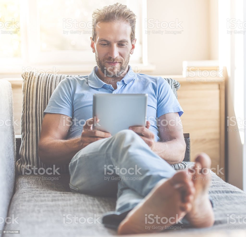 Handsome man at home stock photo
