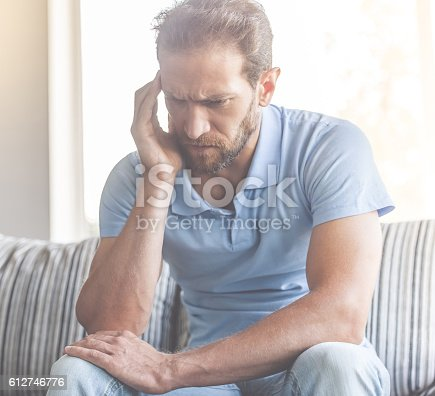 530281733istockphoto Handsome man at home 612746776
