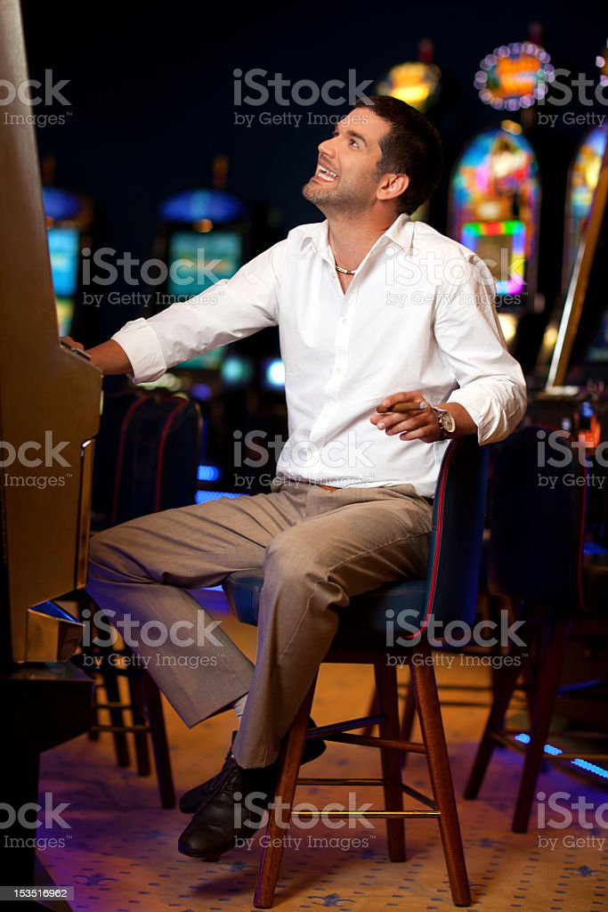 handsome man at the slot machine royalty-free stock photo