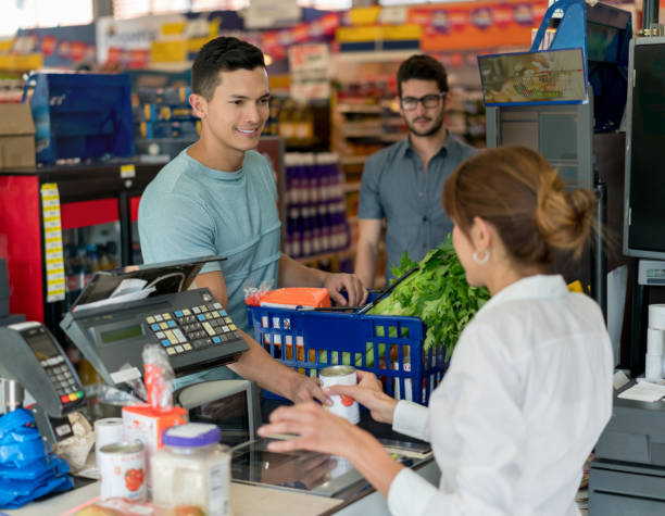 Handsome man buying groceries at a food store and another customer picture id955049984?b=1&k=6&m=955049984&s=612x612&w=0&h=w blhouw5threjpoakrbfgpfwavsufyb2ohimohrufk=