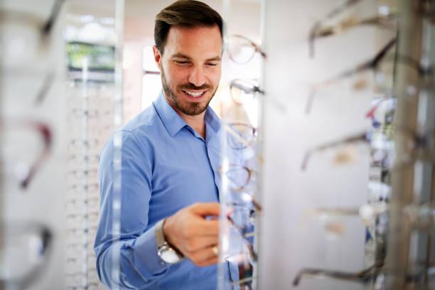Handsome man choosing glasses in optics store picture id1179731227?b=1&k=6&m=1179731227&s=612x612&w=0&h=gqagpexm2msfeki2dunfel7vme4kswrplnf0hbayf q=