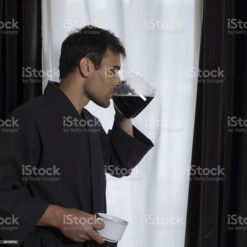 handsome man coffee addiction in a bathrobe morning royalty-free stock photo