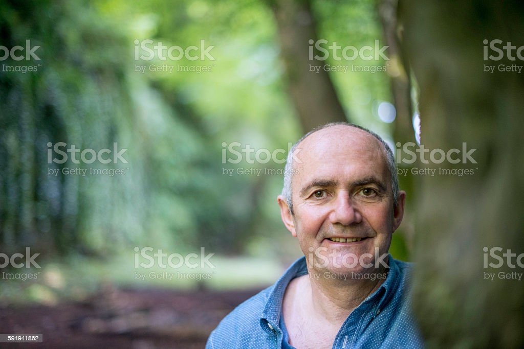 Handsome man deep in the forest royalty-free stock photo