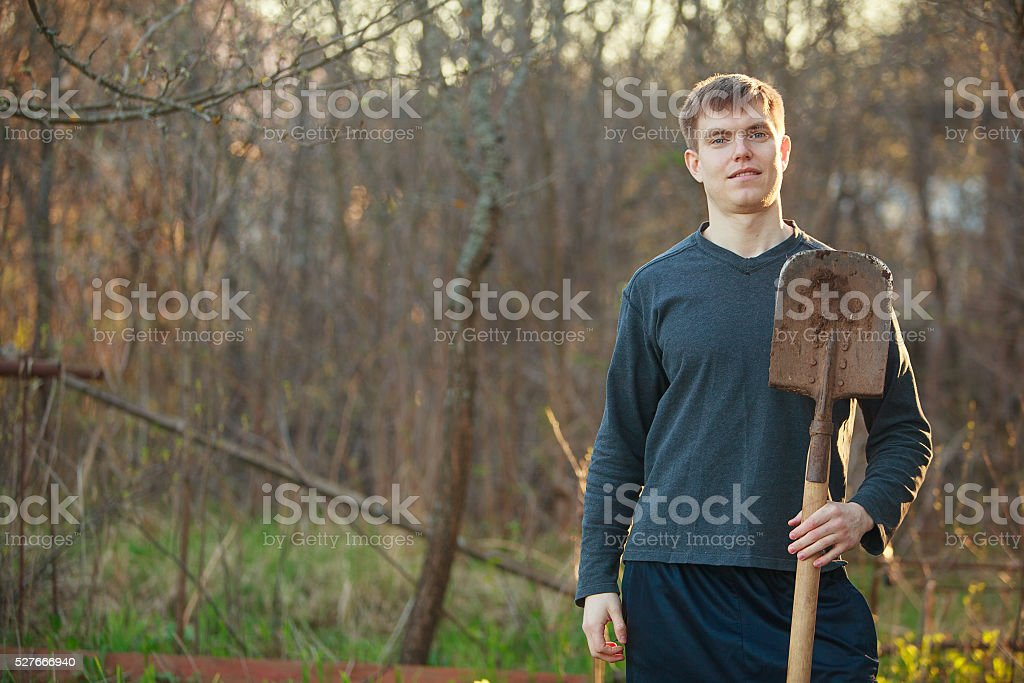 handsome man digging stock photo