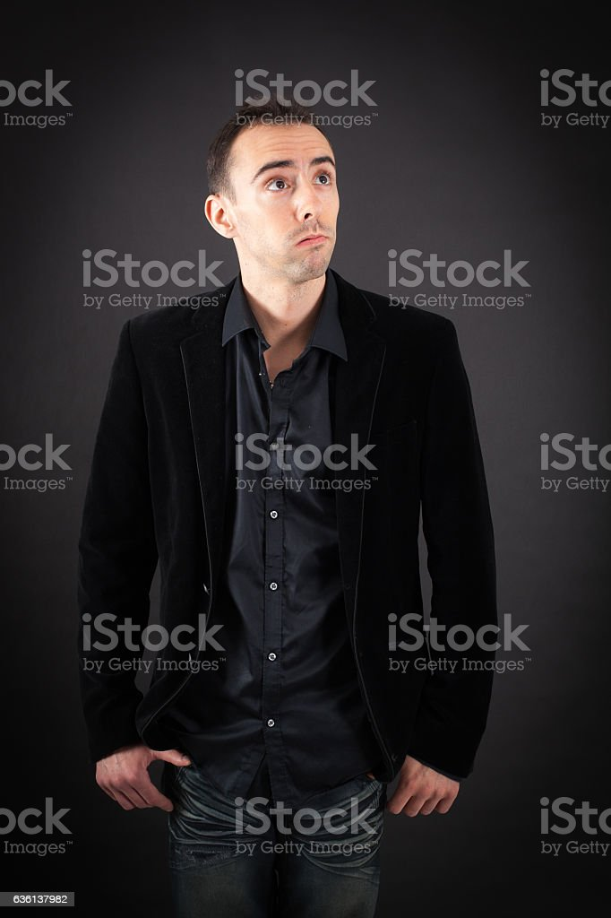 Handsome man doing different expressions in different sets of clothes: bored stock photo