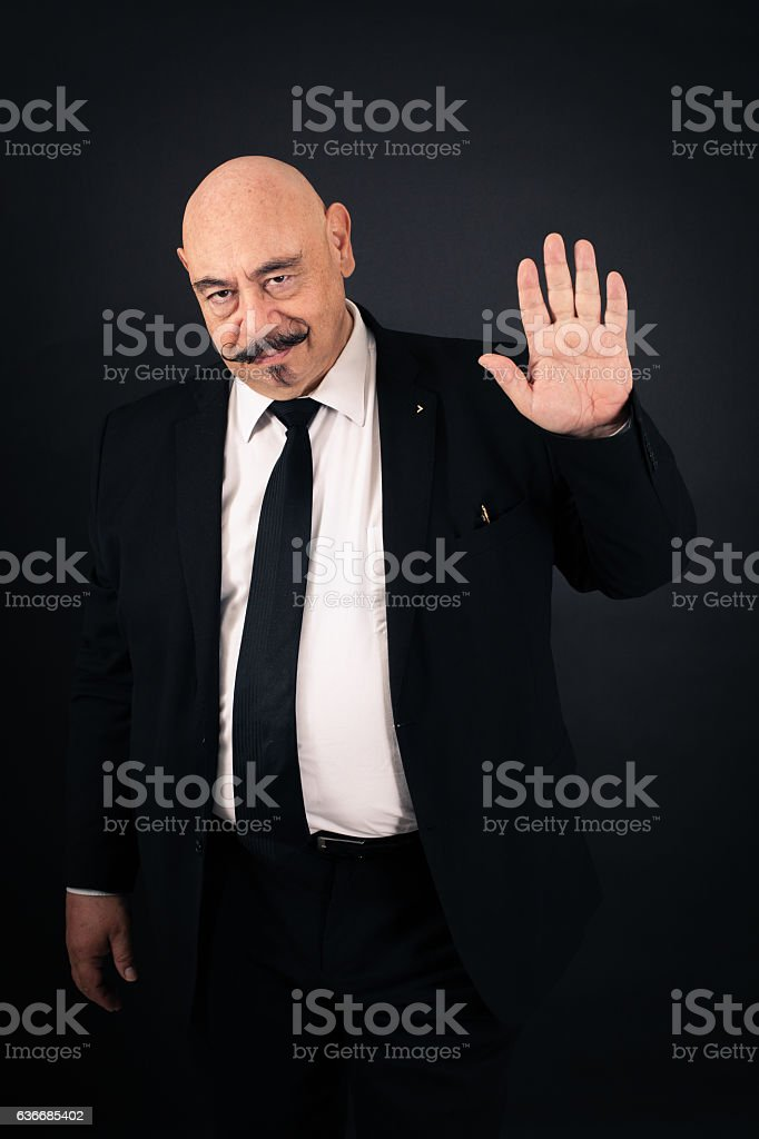 Handsome man doing different expressions in different sets of clothes: waving stock photo
