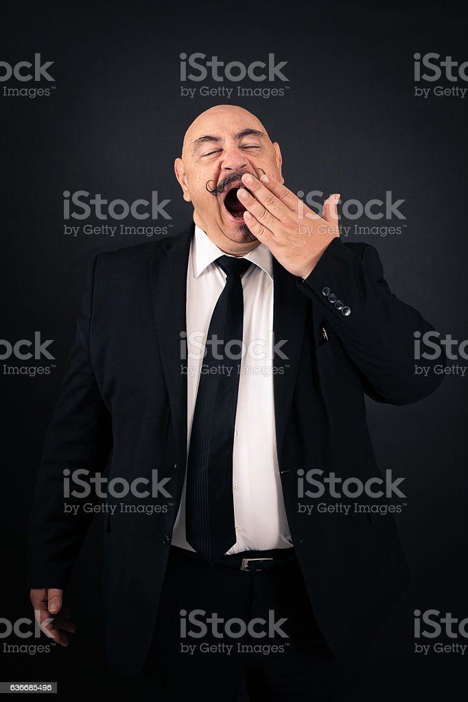 Handsome man doing different expressions in different sets of clothes: yawn stock photo