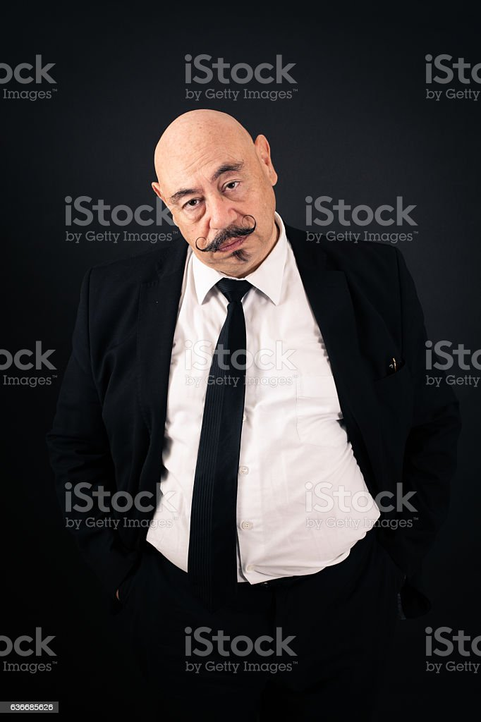 Handsome man doing different expressions in different sets of clothes: tired stock photo