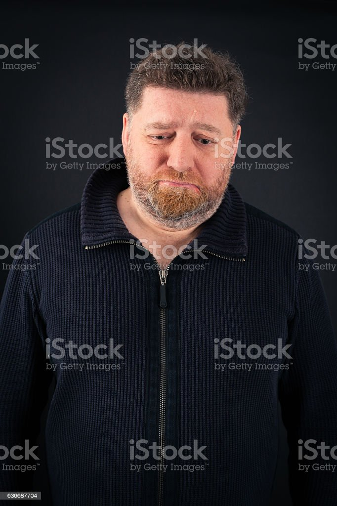 Handsome Man doing different expressions in different sets of clothes: sad stock photo