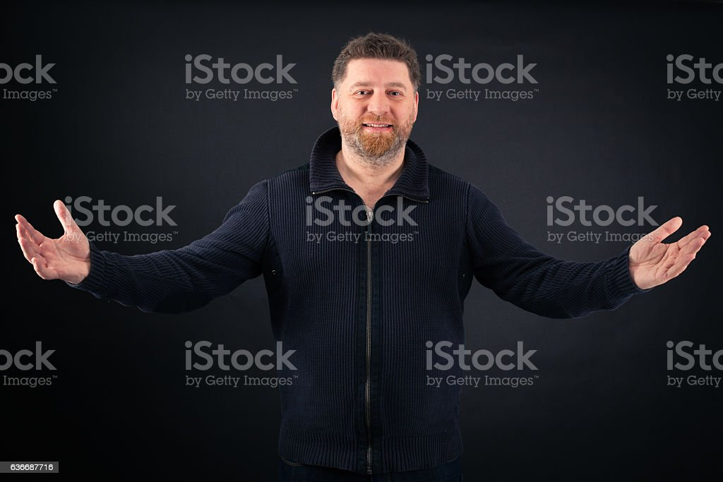 Handsome Man doing different expressions in different sets of clothes: welcome stock photo