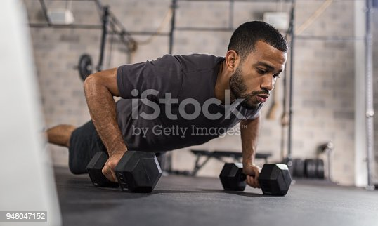 istock Handsome Man Doing Push Ups Exercise 946047152