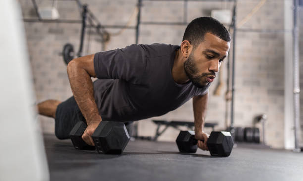 Handsome Man Doing Push Ups Exercise stock photo