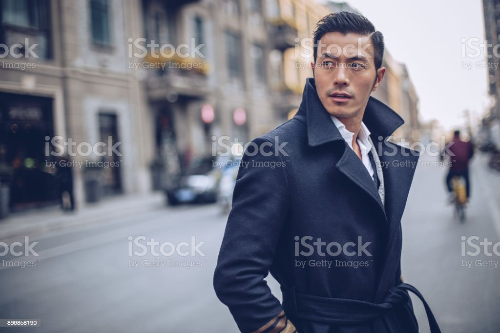 Handsome man downtown stock photo
