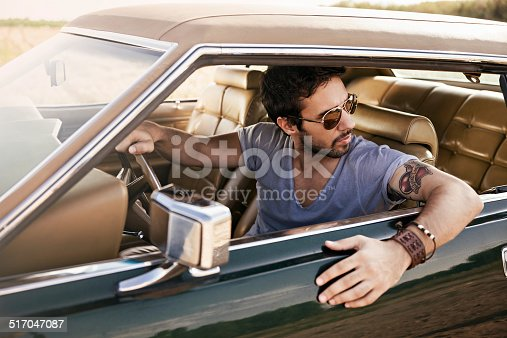 Close up of a handsome young man driving car