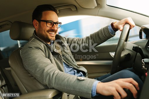 Handsome man driving car