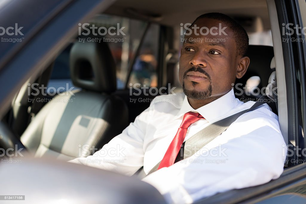 Handsome man driving his car stock photo