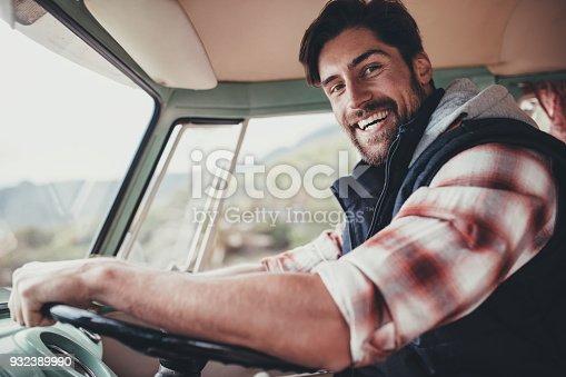 937331052istockphoto Handsome man driving van on his road trip 932389990