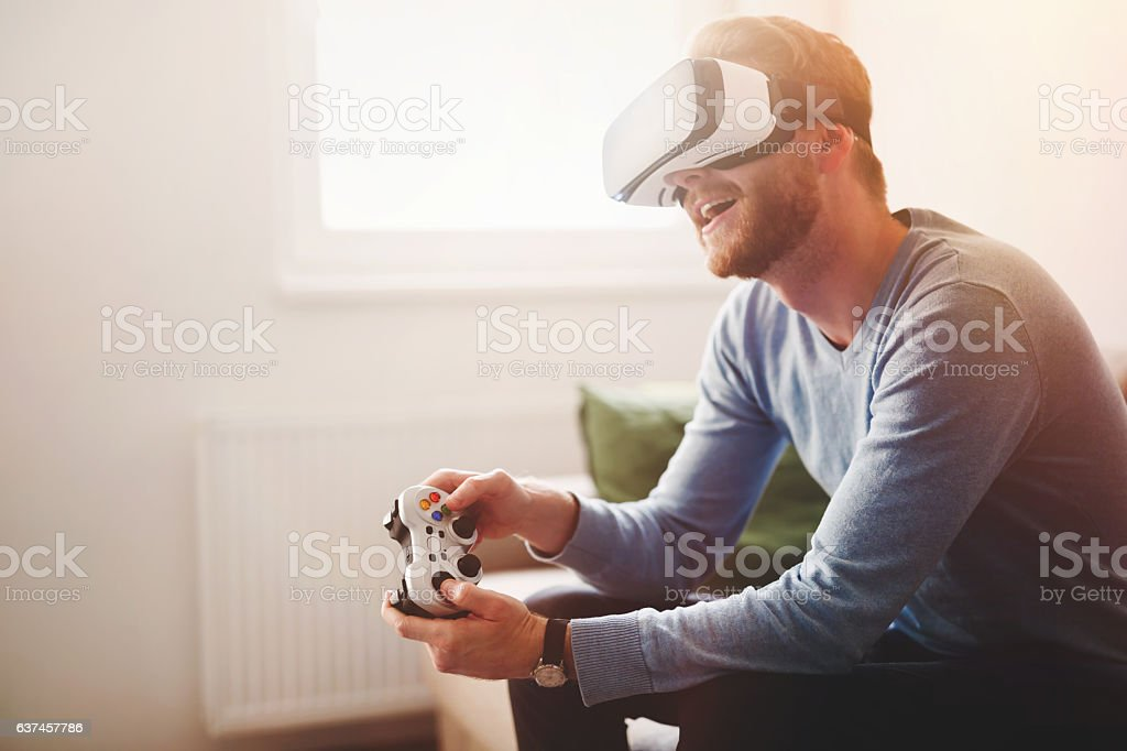Handsome man enjoying games and vr stock photo
