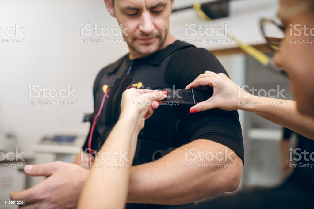 Handsome man getting prepared for ems training stock photo