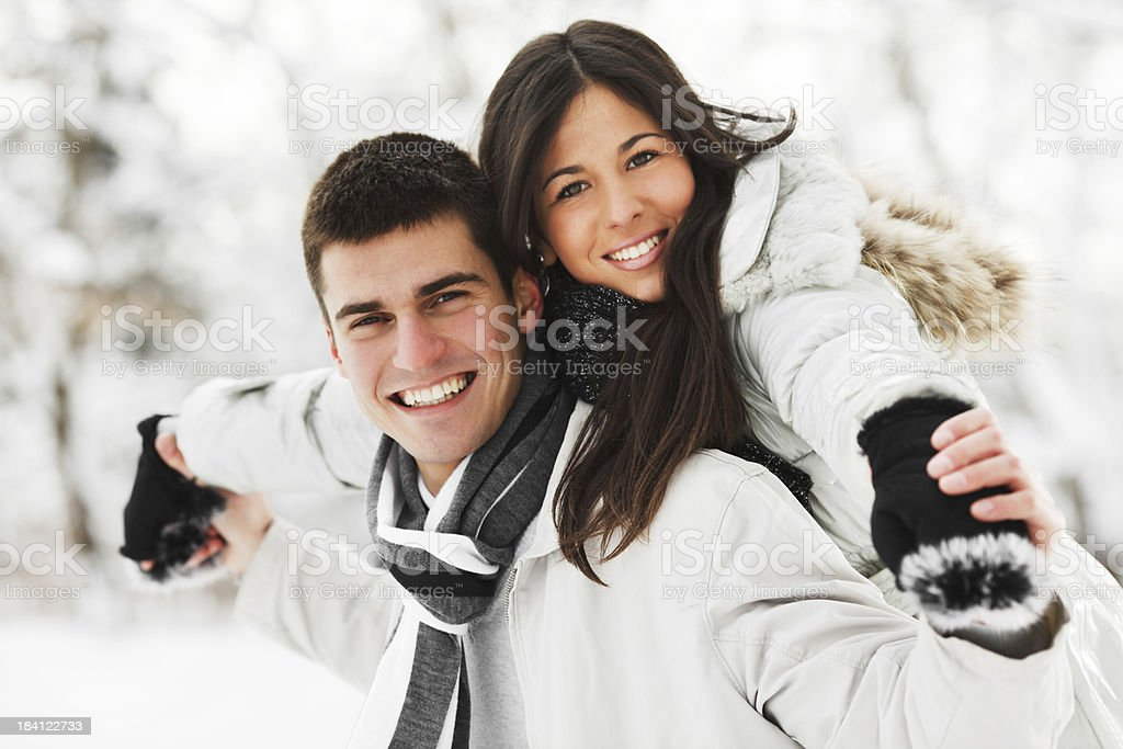 Handsome man giving his girlfriend a piggyback ride royalty-free stock photo