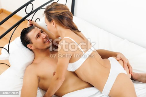 istock Handsome man having sex with woman 450287095