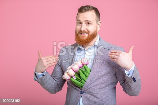 1125461272 istock photo Handsome man holding bouquet of tulips 922023182