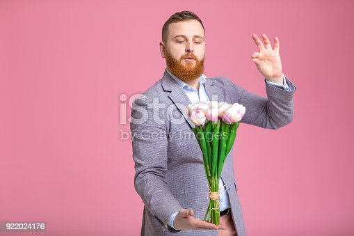 1125461272 istock photo Handsome man holding bouquet of tulips 922024176