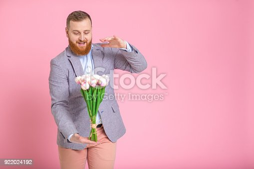 1125461272 istock photo Handsome man holding bouquet of tulips 922024192