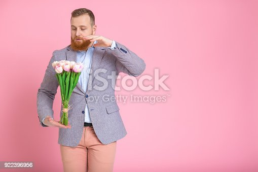 1125461272 istock photo Handsome man holding bouquet of tulips 922396956