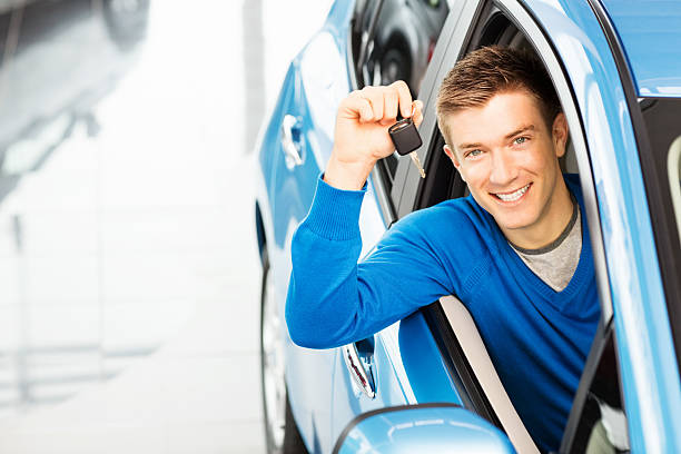 Handsome Man Holding Car Key stock photo