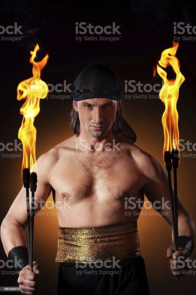Handsome man holding torches royalty-free stock photo