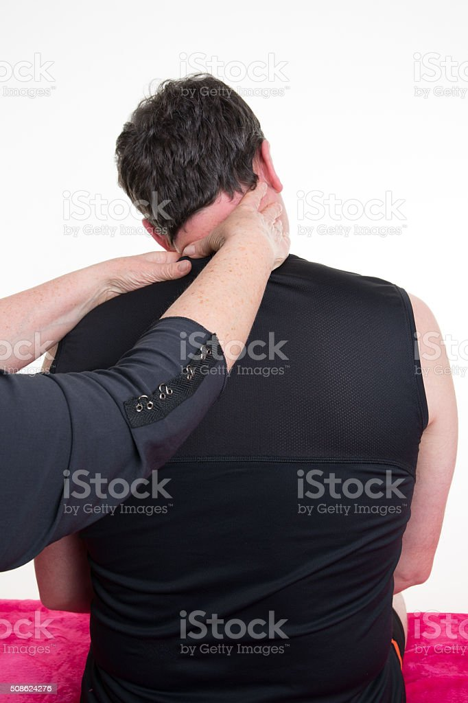 Handsome  man in a spa having a shoulder massage stock photo