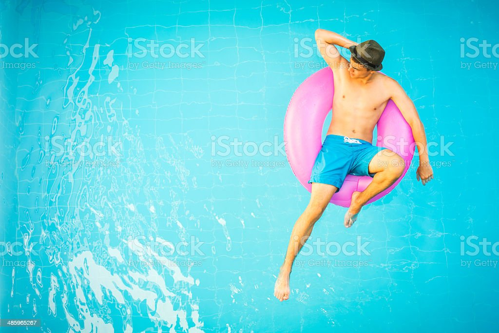 Handsome man in a swimming pool stock photo