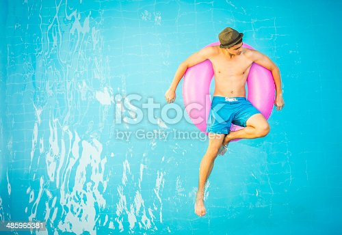 Handsome young man in a swimming pool