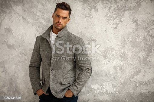 Portrait of handsome man in gray stylish jacket with copy space for your text