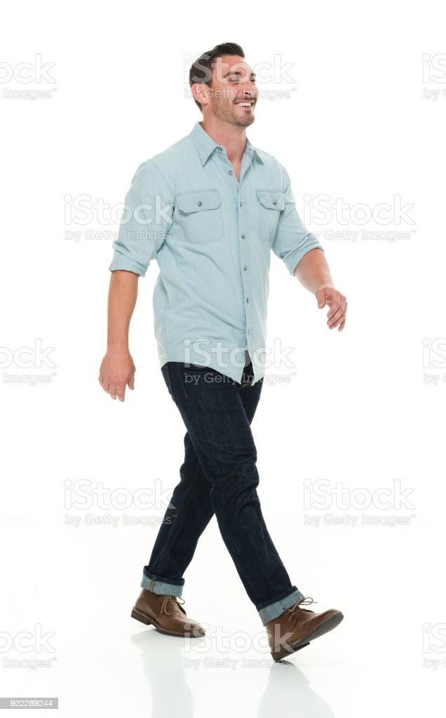 Handsome man in casual clothes walking stock photo