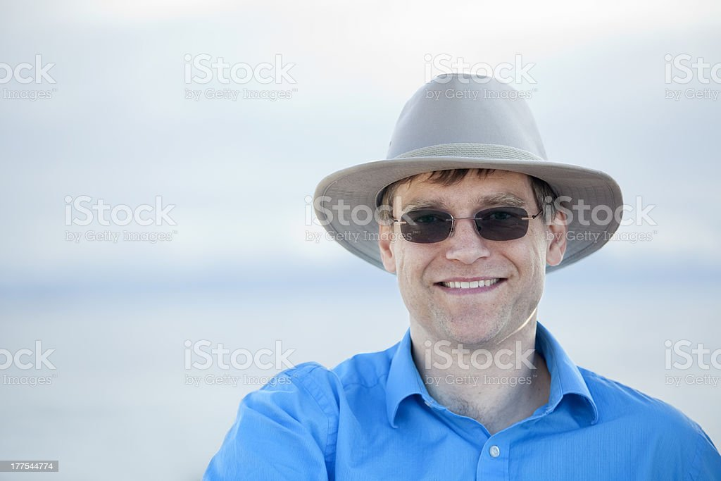 Handsome man in early forties with blurred water background royalty-free stock photo