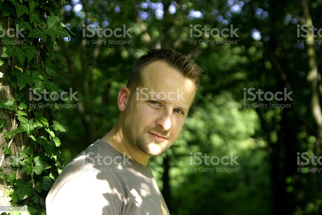 handsome man in forest stock photo
