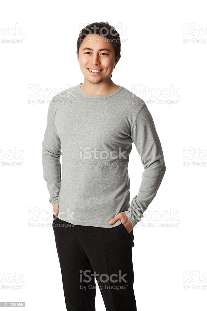 Handsome man in grey shirt with hands in pocket ストックフォト