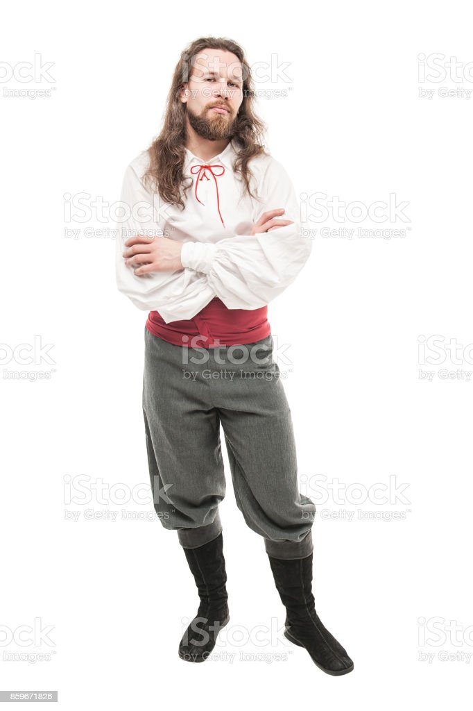 Handsome man in historical pirate costume isolated stock photo