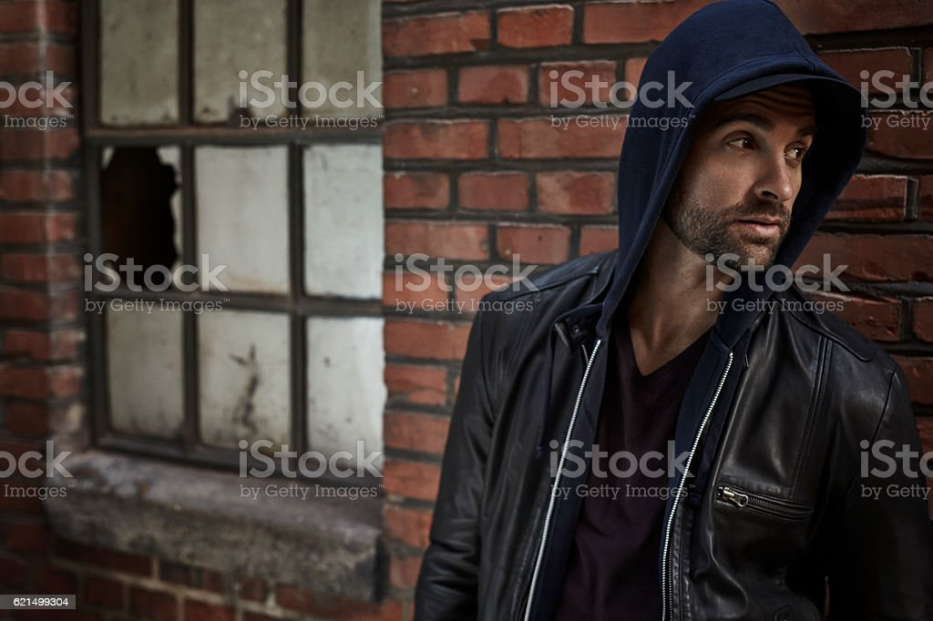 Handsome man in hooded top, looking away foto stock royalty-free