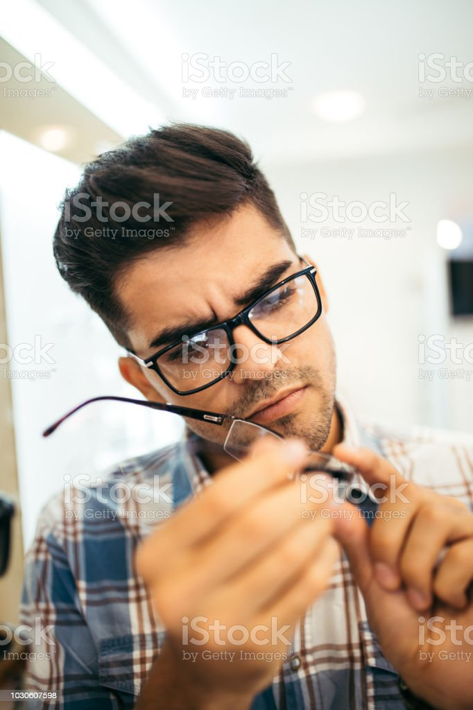 Handsome man in optical store stock photo