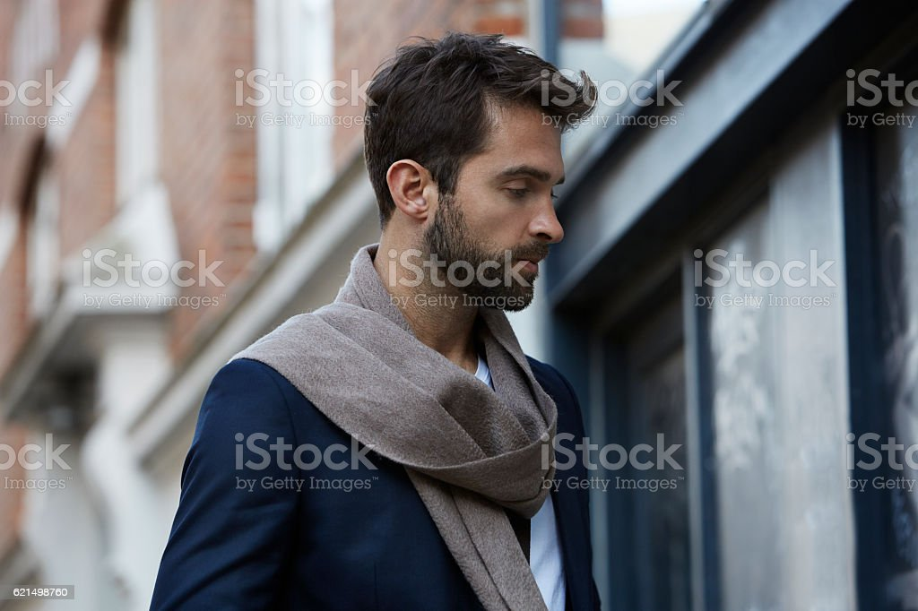 Handsome man in scarf, profile foto stock royalty-free