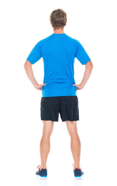 Handsome man in sports clothing Attractive man in sports clothing akimbo stock pictures, royalty-free photos & images