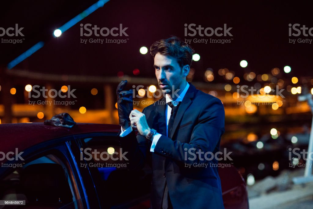 handsome man in suit late night in the city royalty-free stock photo