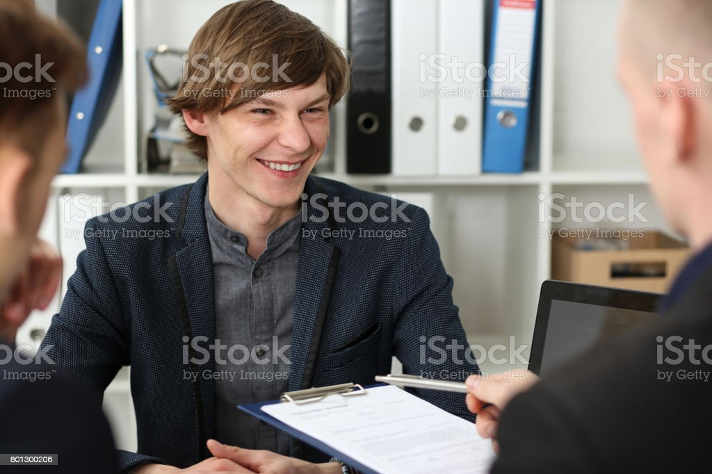 Handsome man in suit offer contract form on clipboard pad stock photo