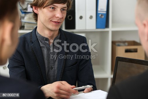 863148614istockphoto Handsome man in suit offer contract form on clipboard pad 801300216
